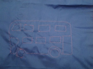 Straight stitched bus design, there is a red rectangle of fabric behind...