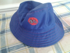 Reverse side in blue, with tractor logo and red topstitching