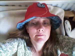 Red stretch denim with swirl / penguin hat