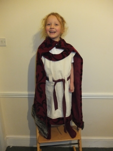 Cream and red version (the tunic is a little off the shoulder on this one but no one will notice under the cloak)