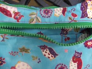 zipped pocket with secret pocket peeking out