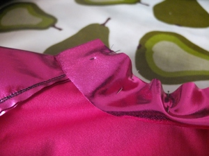 Pinning the binding on, right side to wrong side of neckline