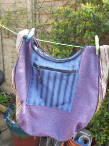 blue stripey pocket feature with reclaimed zip