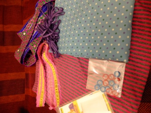 Modest Haul. Spotty Cordrouy, stripey jersey, clear elastic, cat and heart buttons all from Guthrie and Ghani. Lacey ribbon, fancy trim and what will hopefully be suitable purple knicker elastic, all from the Rag Market.