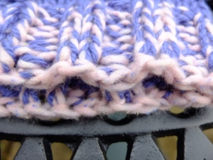 I just used the pink strand to cast of using the incredibly stretchy bind off method