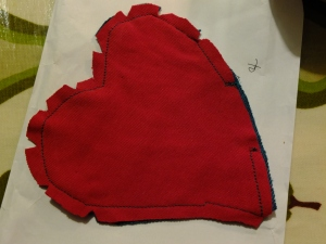 """Pocket and lining stitched together and clipped ready to turn. Then the top """"M"""" shape was topstitched before placing on the cardy and sewing the rest into place."""