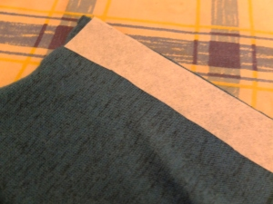 Interfacing the button band before folding it over and sewing it down.