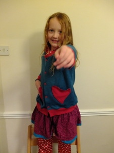 Here's looking at you kid. (and yes, she's wearing that over polka dot pajama's and with a skirt. Long story)