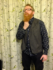 The Man decided to do Humourous Poses. (He was about to go on his Works Night Out and was in a good mood - so all these photo's are before the waistcoat was actually finished). I think this is him doing up his top button.