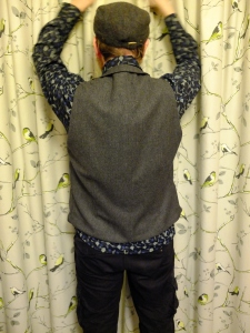 Closing the curtains back view pose