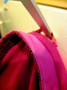 understitching on collar and hanging loop in action