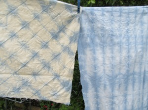 the one on the left is off white an unsurprisingly took the dye a bit differently from the white fabric on the right.