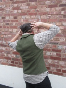 """he was taking the mick out of me making him stand in front of a """"blogging wall"""" by doing """"interesting"""" poses. The creases aren't there when he stands naturally"""
